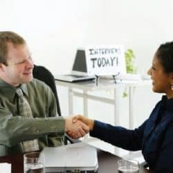 Woman shaking hands with recruiter