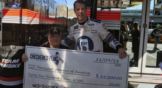 Brad Keselowski presents check to Bill Lawson