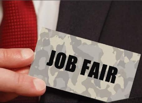 Man holding a Job Fair sign