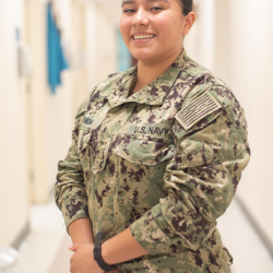 Hospitalman Monica Carmona poses in her fatigues with a smile
