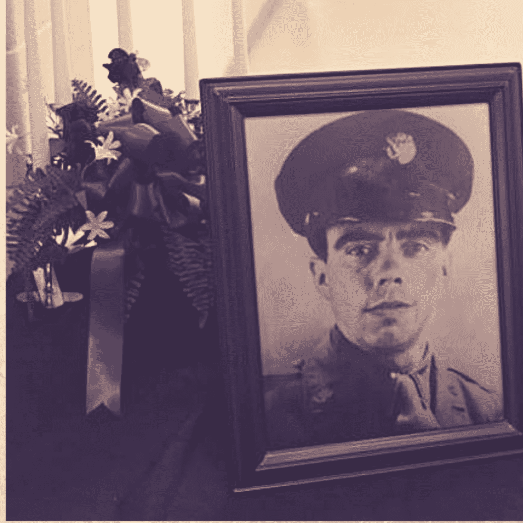 A picture of World War II soldier Pfc. Clifford M. Mills is displayed at his funeral.
