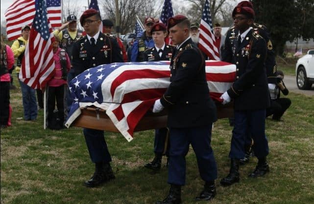 The casket of World War II soldier Pfc. Clifford M. Mills is carried at his funeral.
