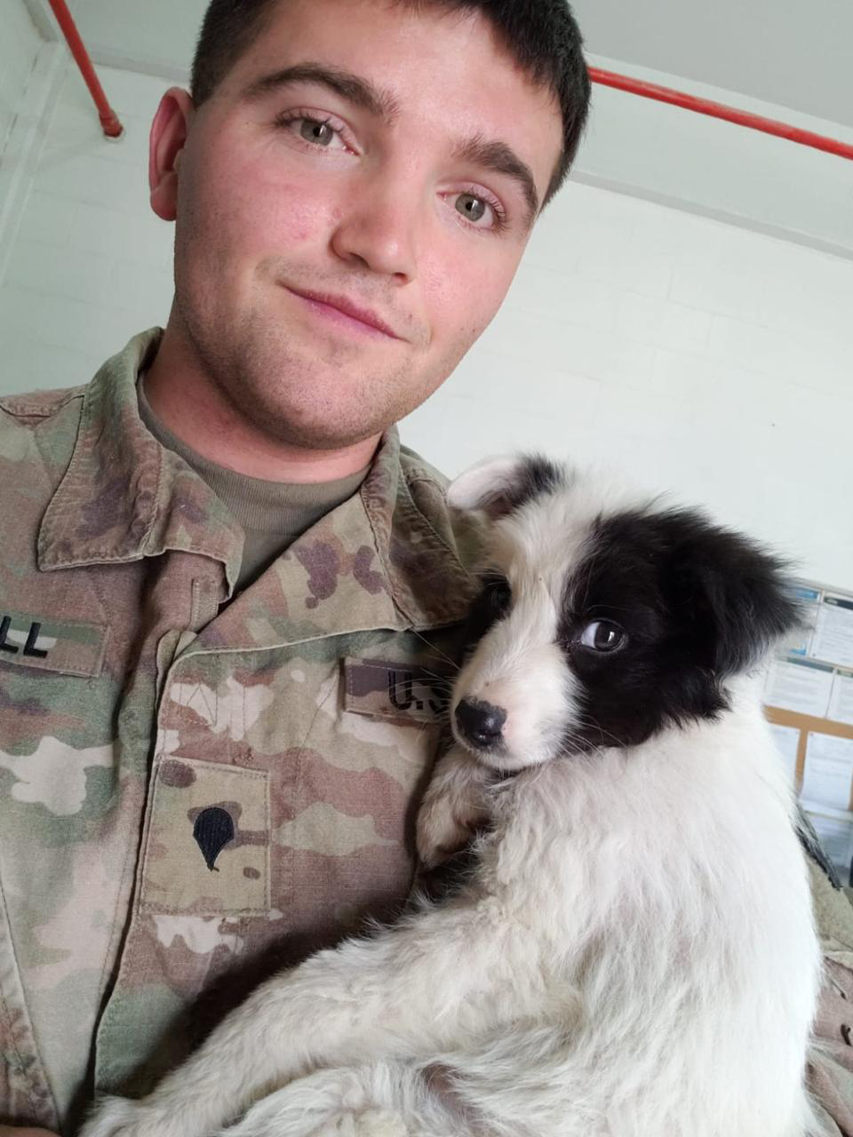 Bucky with soldier stationed in the Middle East