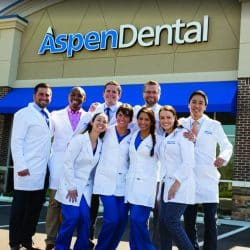 Aspen Dental coworkers posing outside of office