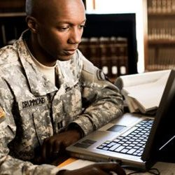 veteran looking at document on his laptop