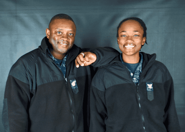 U.S. Navy father and daughter poese together smiling