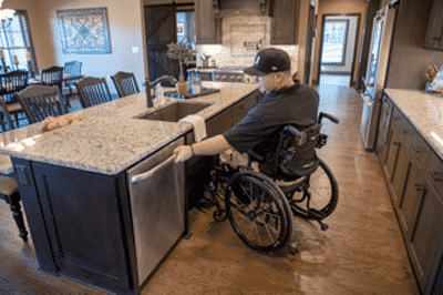 Disabled veteran sitting in wheelchair in his smart home with disability access