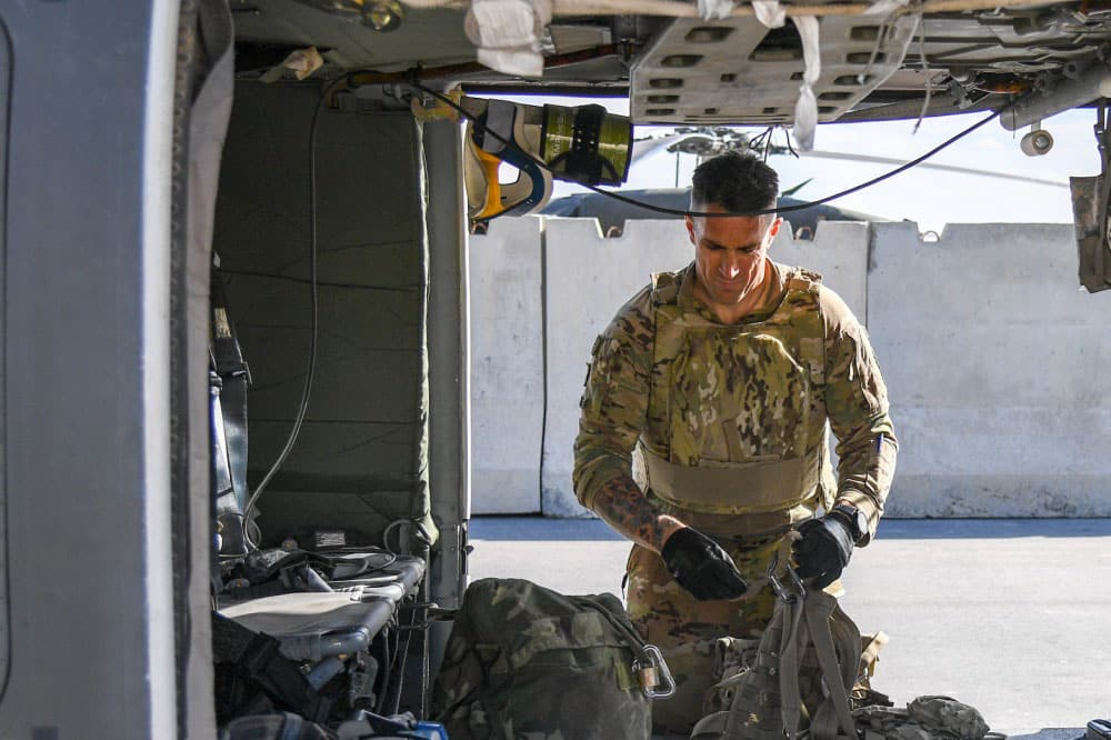 Army soldier in uniform at his command post