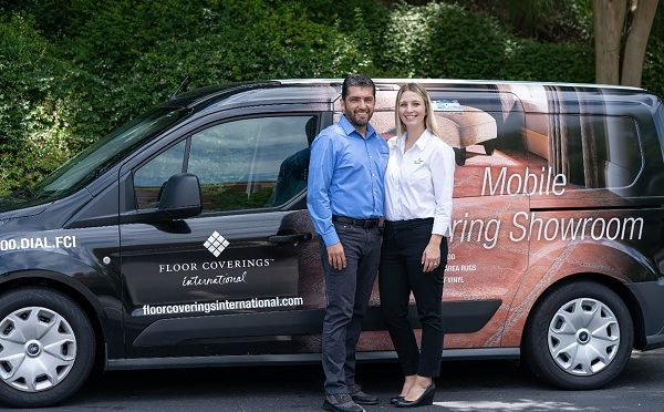 Jennifer & Jose Elias stand in front of their Floor Coverings International vehicle