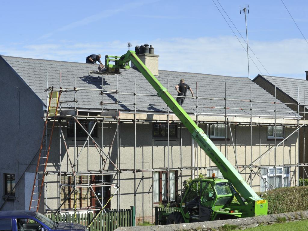 picture of two men working on a new roof
