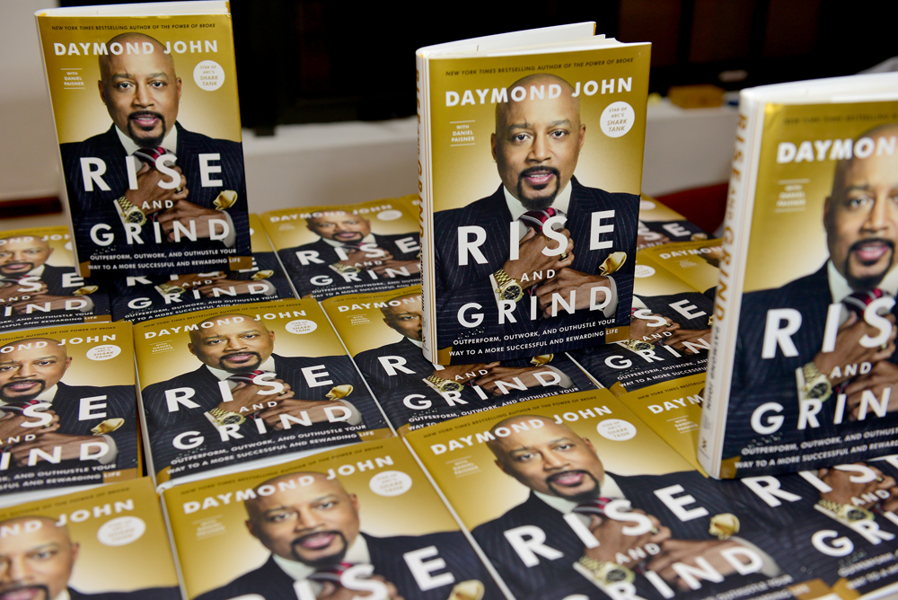 Daymond John books on display at book signing