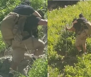 Veteran carrying his disabled Marine buddy on his back up a hill while hiking