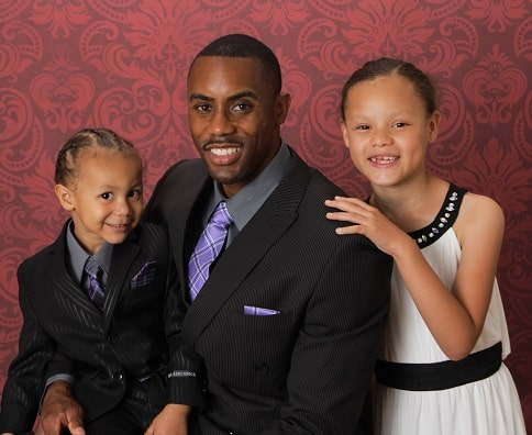 Michael Landry portrait with children Makiya and Michael III