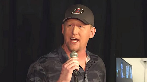 Robert O'Neill holding microphone during stand up comedy routine