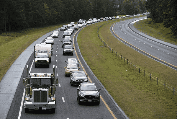 hurricane evacuees on the road leaving town in droves