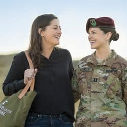 Emilly Nunez and Bestsy Nunez pose with Emily carrrying an army green signature military bag