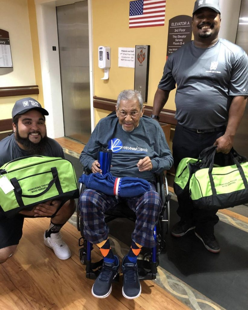 Two Men deliver duffels to patients at medical center in Fayetteville