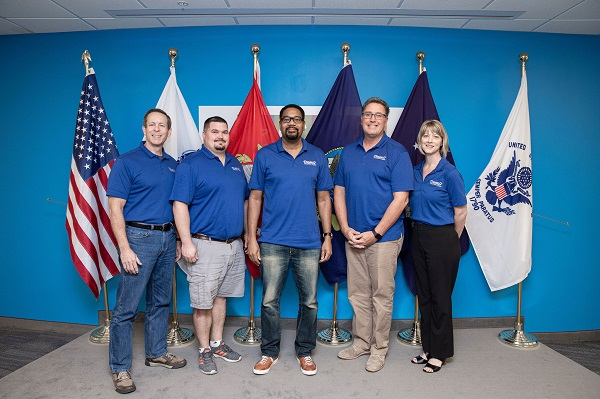 2019 Operation Vetrepreneur Winners pose together with U.S. Flags in the background
