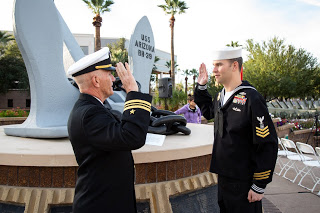 Master at Arms 1st Class Petty Officer Christopher Kurz took the oath of enlisment from Lt. Cmdr. Phillip Fortnam at the USS Arizona Memorial at the Wesley Bolin Memorial Plaza in Phoenix, Ariz. on December 7, 2019