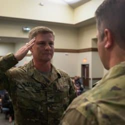 Deputy Commander Col. Steven M. Marks salutes a 2nd Battalion, 7th Special Forces Group (Airborne) soldier during a ceremony at the chapel on Eglin Air Force Base