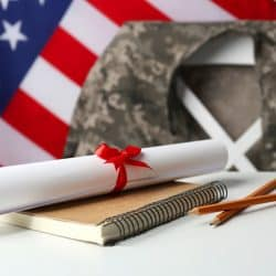 Notebook, diploma and pencils on white table image for military education