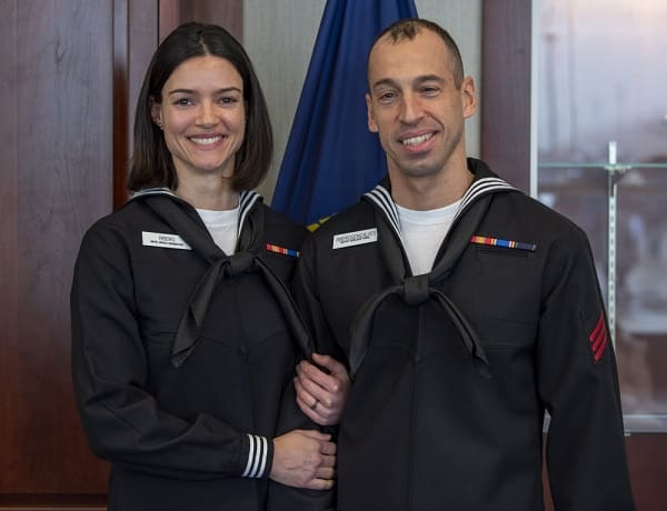Silvia and Rafael Gonclaves pose in U.S. Navy Uniforms