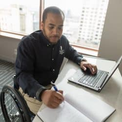 disabled veteran in wheelchair looking online for employment