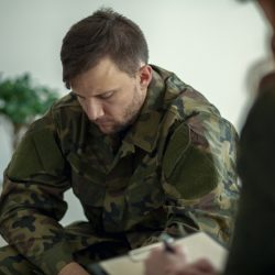 Soldier sitting and talking to his therapist