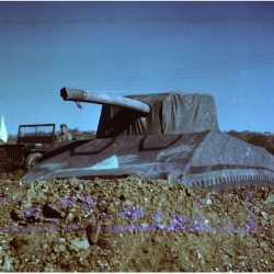An Inflatable Tank used in WWII sits on a rugged hill