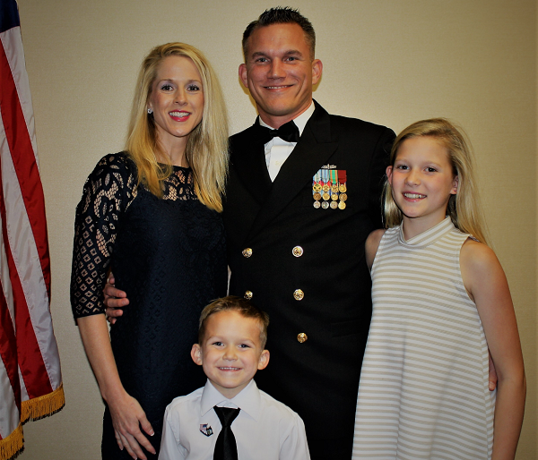 Bryan Bergjans with his family at an awards ceremony