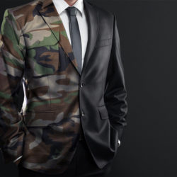 A male body wearing a suit that is half black and half camoflauge